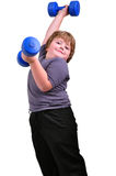 Isolated portrait of kid exercising with dumbbells Stock Image