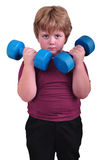 Isolated portrait of kid exercising with dumbbells Stock Photo