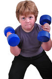 Isolated portrait of kid exercising with dumbbells Royalty Free Stock Photography