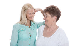 Isolated portrait of real grandmother with her granddaughter. Royalty Free Stock Image