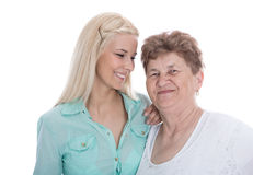 Isolated portrait of real grandmother with her granddaughter. Royalty Free Stock Photo