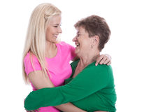 Isolated portrait of real grandmother with her granddaughter hug Stock Photo