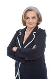 Isolated portrait of a satisfied senior female business woman. Isolated portrait of a satisfied senior female business woman in blue blazer royalty free stock images