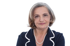 Isolated portrait of a satisfied senior female business woman. Isolated portrait of a satisfied senior female business woman in blue blazer Royalty Free Stock Photography