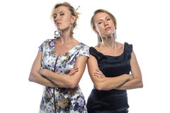 Isolated portrait of sisters standing on white. Isolated photo on white background Stock Image