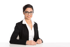 Isolated portrait of sitting secretary with spectacles on white Royalty Free Stock Photo