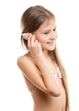 Isolated portrait of smiling girl listening the seashell Stock Photo