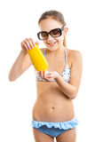 Isolated portrait of smiling girl pouring suntan lotion on hand Royalty Free Stock Photography