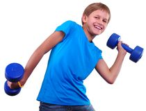 Isolated portrait of smiling kid exercising with dumbbells Royalty Free Stock Photography