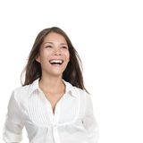 Isolated portrait of smiling laughing woman. Smiling laughing woman portrait - looking at copy space. Beautiful young mixed Chinese Asian / Caucasian woman close Royalty Free Stock Photos