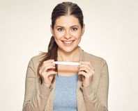 Isolated portrait of smiling young woman holding pregnant test. Studio isolated background Stock Photo