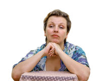 Isolated Portrait of a woman. Elbows are put on a chair. Hands support the head Royalty Free Stock Images
