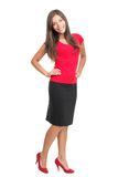 Isolated portrait of woman in full length. Cutout of beautiful young business woman casual dressed in red standing in high heels. Cute mixed race caucasian / Royalty Free Stock Images