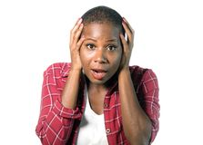 Isolated portrait of young attractive surprised and shocked afro american woman with hands on her head in disbelief and surprise w royalty free stock image