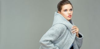 Isolated portrait of young beauty woman wearing gray coat Stock Photos