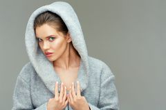 Isolated portrait of young beauty woman wearing gray coat Stock Images