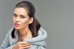 Isolated portrait of young beauty woman wearing gray coat Royalty Free Stock Photography