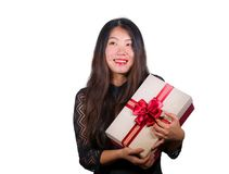 Isolated portrait of young happy and excited beautiful Asian Chinese woman receiving a romantic anniversary gift box holding the. Red ribbon present cheerful royalty free stock photos