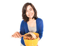 Isolated portrait of young happy woman preparing pasta on white Stock Photography