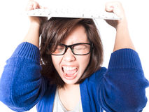Isolated portrait of young stress woman with computer keyboard o. N white background. Pretty eyeglasses female model angry Royalty Free Stock Photo
