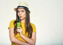 Portrait of young woman drinking juice. Isolated portrait of young woman drinking juice with straw Stock Images
