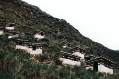 isolated praying huts up on the side of the hill for tibetan buddhist monks to meditate royalty free stock image