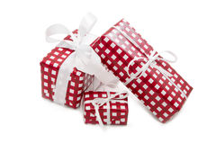 Isolated presents wrapped in checkered paper for christmas Stock Photos
