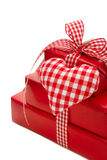 Isolated presents wrapped in red paper with a checked heart Royalty Free Stock Image