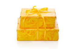 Isolated presents wrapped in yellow patterned paper Royalty Free Stock Photography