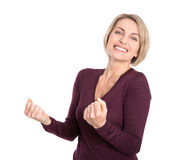 Isolated pretty mature blond woman with fists on white. Stock Photo