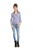Isolated pretty woman in blue jeans and full body length. Attractive businesswoman in blue jeans and full body length isolated on white background Stock Image