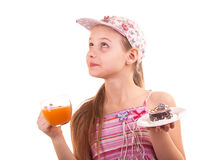 Pretty young girl looking with and juice cake on white backgroun Royalty Free Stock Image