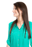 Isolated pretty young woman looking sideways in green blouse on Stock Images
