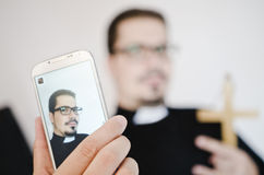 Isolated priest selfie Royalty Free Stock Image