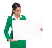 Isolated professional businesswoman in green holding white sign Stock Photos