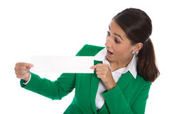 Isolated professional businesswoman in green holding white sign Royalty Free Stock Photos