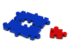 Isolated puzzle. Red puzzle to represent a person is isolated from the team Stock Photos