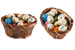 Isolated quail eggs in a basket with decorative wooden balls. Still Life with quail eggs in a basket with decorative wooden balls isolated on white background Royalty Free Stock Images