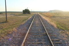Isolated railway line with straight railway tracks leading into the distance Royalty Free Stock Image