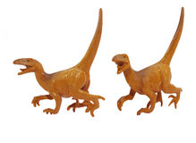 Isolated Raptor dinosaur toy photo. Royalty Free Stock Photography