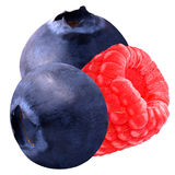 Isolated raspberry and blueberries. Isolated berries. One sweet raspberry and two blueberries isolated on white background with clipping path royalty free stock photography