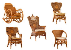 Isolated rattan armchairs and rocking chair Royalty Free Stock Photo