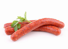 Isolated raw sausage. And parsley on white Stock Photo