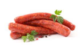 Isolated raw sausage. And herbs Stock Photography