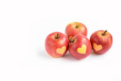 Isolated red apples with shape of heart on a white background Stock Photo