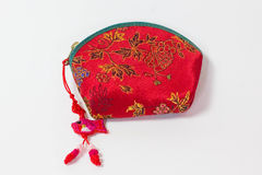 Isolated Red Asian Coin Purse. An isolated, closed, red, Asian coin purse with a fish tassle Royalty Free Stock Images
