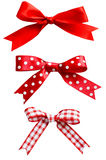 Isolated Red bows. Three types of isolated red ribbon bows on white background.  One plain, two patterned with polka dots and checks Royalty Free Stock Photography