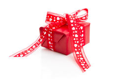 Isolated red box with heart patterned ribbon Stock Photography