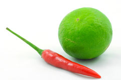 Isolated red chilli and green lime Stock Photo
