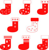 Isolated Red Christmas Stockings. Isolated white and red Christmas stockings illustrations, Christmas decorations, Christmas stockings, red snowflakes Royalty Free Stock Images